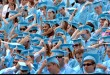 Graduates turn their mortarboard tassels to signify that they had officially graduated during Commencement at the University of North Carolina at Chapel Hill Sunday.